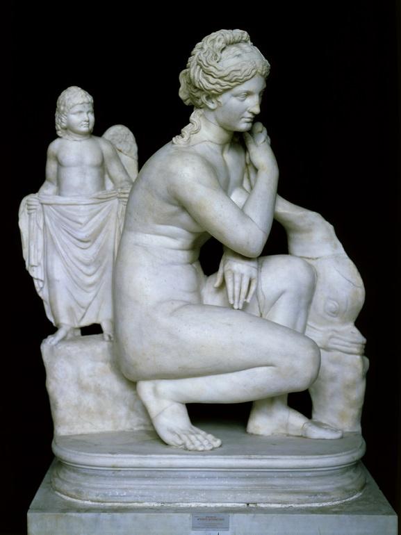 Statue of crouching Aphrodite with dolphin