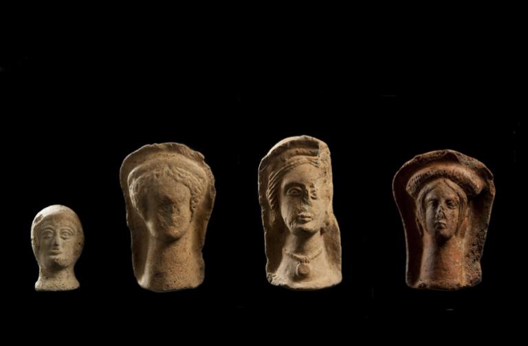Clay votive heads